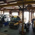 Heavy Duty Trucks and Buses Being Repaired