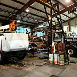 Heavy Equipment Trucks Being Repaired At Alberta Heavy Equipment Repair Shop